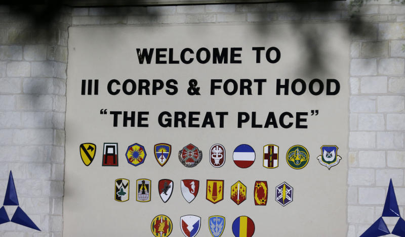 The main entrance of the Army base is shown where the the start of the court-martial of Maj. Nidal Malik Hasan is taking place Tuesday, Aug. 6, 2013, in Forth Hood, Texas. After years of delays, the trial of the man who carried out the Fort Hood shooting is starting, with Hasan representing himself against charges of murder and attempted murder for the 2009 attack that left 13 people dead on the Army post. (AP Photo/LM Otero)