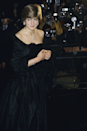 <p>Anyone who's seen The Crown will remember this strapless black dress is what Diana wore for her first official public engagement with Charles. Notably, it was the gown's revealing neckline that caused a stir as a marked shift from the family's more conservative dress code. </p>