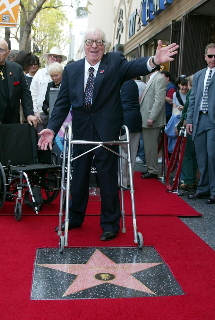 Ray Bradbury was honored with a star on the Hollywood Walk of Fame for his achievements in film at Hollywood Boulevard in Hollywood, California, on April 1, 2002. (Photo by Albert L. Ortega/WireImage)