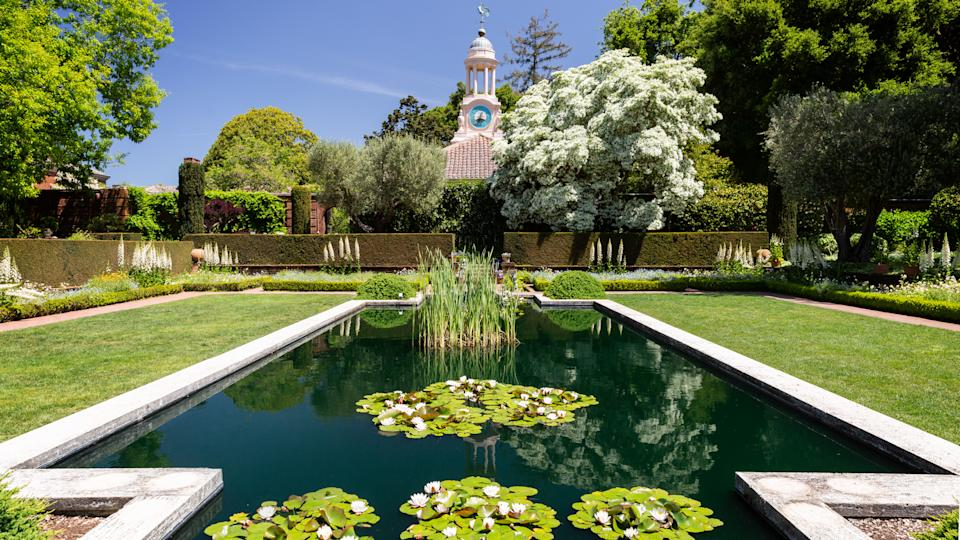 San Carlos, California, USA - May 05, 2019: A pond in Filoli estate garden on sunny day with blue sky - Image.