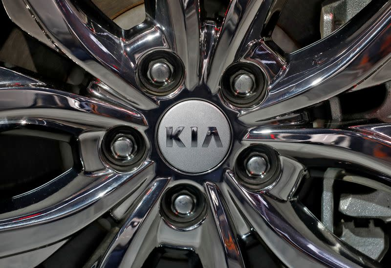 The logo of Kia Motors is seen on a wheel of its Carnival car at the India Auto Expo 2020 in Greater Noida