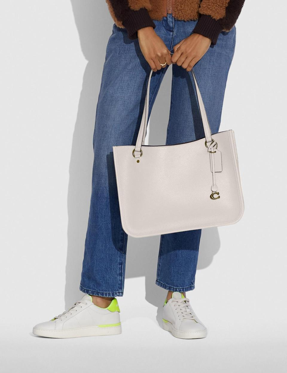 <p>The <span>Coach Tyler Carryall</span> ($350) is the perfect everyday bag.</p>