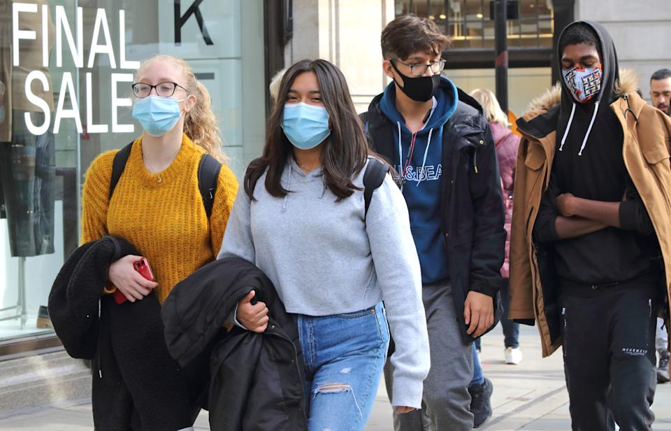 Shoppers wearing facemasks walk along Regent Street Public people are seen wearing facemasks while out shopping in London following prime minister, Boris Johnson's announcement of a new three tier lockdown system because of the increasing cases of coronavirus infections in the UK. (Photo by Keith Mayhew / SOPA Images/Sipa USA)