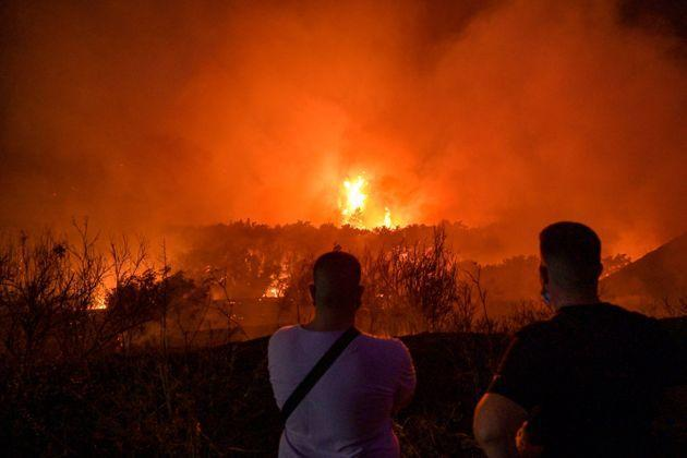 ATHENS, GREECE - AUGUST 03:Local residents watch a wildfire in the area of Tatoi areia on August 3, 2021 in Athens, Greece (Photo: Milos Bicanski via Getty Images)