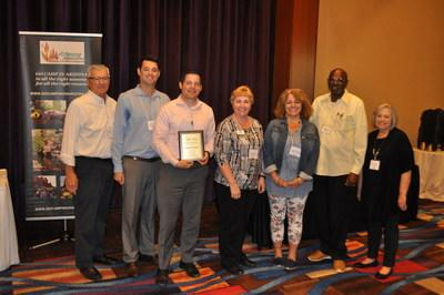 Voyager RV Resort Manager, Geoffrey Campbell presented with the 2019 ARVC Mega Park of the Year Award. Colleagues Debby Mitchell, Lisa Glendinning and James Marshall from Voyager are also in attendance. Representatives from AZ ARVC are Co-Executive Directors Dave Schenck and JoAnn Mickelson along with John Sheedy, President of the Executive Committee for AZ ARVC.