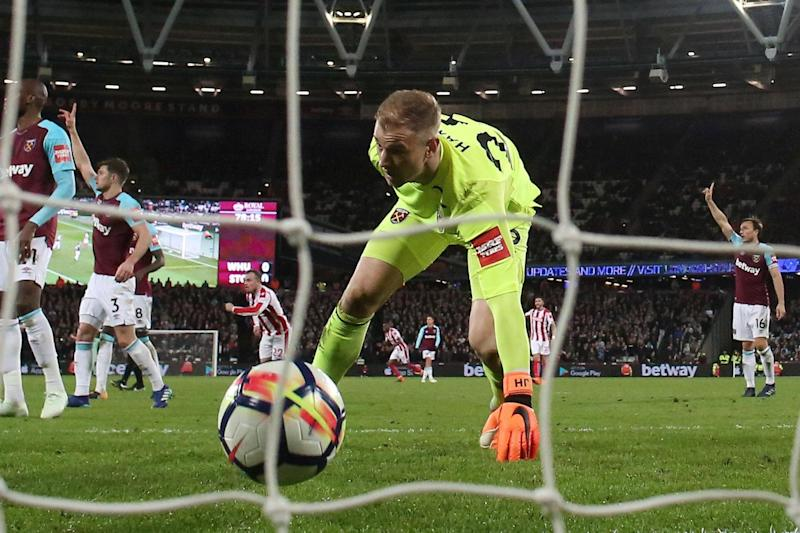 Jeepers keepers: Joe Hart picks the ball out of the net after his error against Stoke: REUTERS