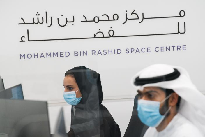Emirati scientists prepare for the launch of the Emirates' Hope space probe to Mars at the Mohammed bin Rashid Space Centre in Dubai, United Arab Emirates, Sunday, July 19, 2020. A Japanese H-IIA rocket carrying a United Arab Emirates Mars spacecraft has been placed on the launch pad for Monday's scheduled liftoff for the Arab world's first interplanetary mission, officials said Sunday. (AP Photo/Jon Gambrell)
