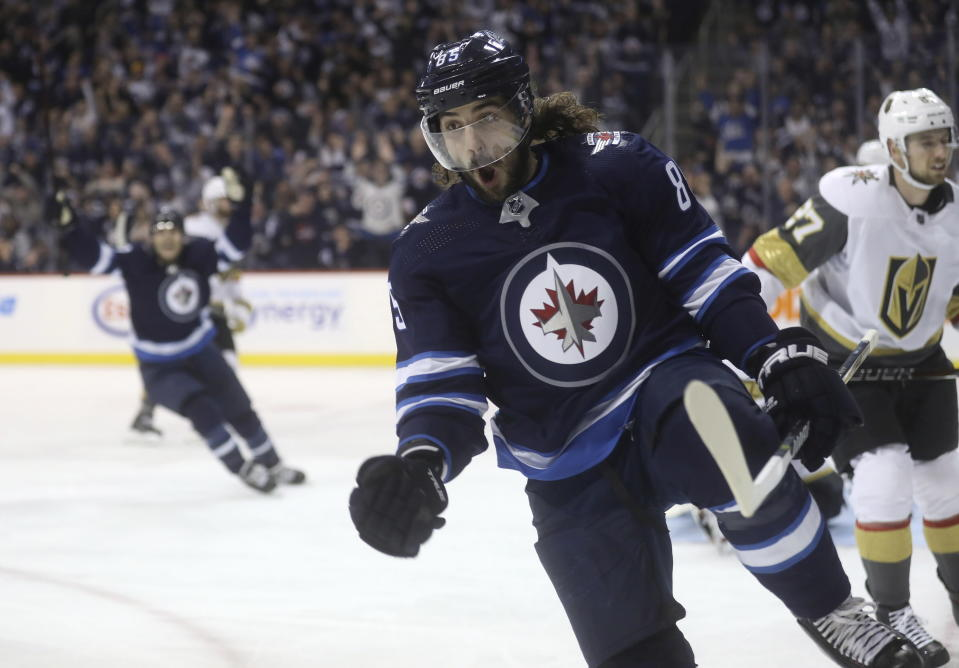 Winnipeg Jets' Mathieu Perreault (85) celebrates after scoring on Vegas Golden Knights goaltender Marc-Andre Fleury as Shea Theodore (27) skates nearby during the second period of an NHL hockey game Tuesday, Jan. 15, 2019, in Winnipeg, Manitoba. (Trevor Hagan/The Canadian Press via AP)