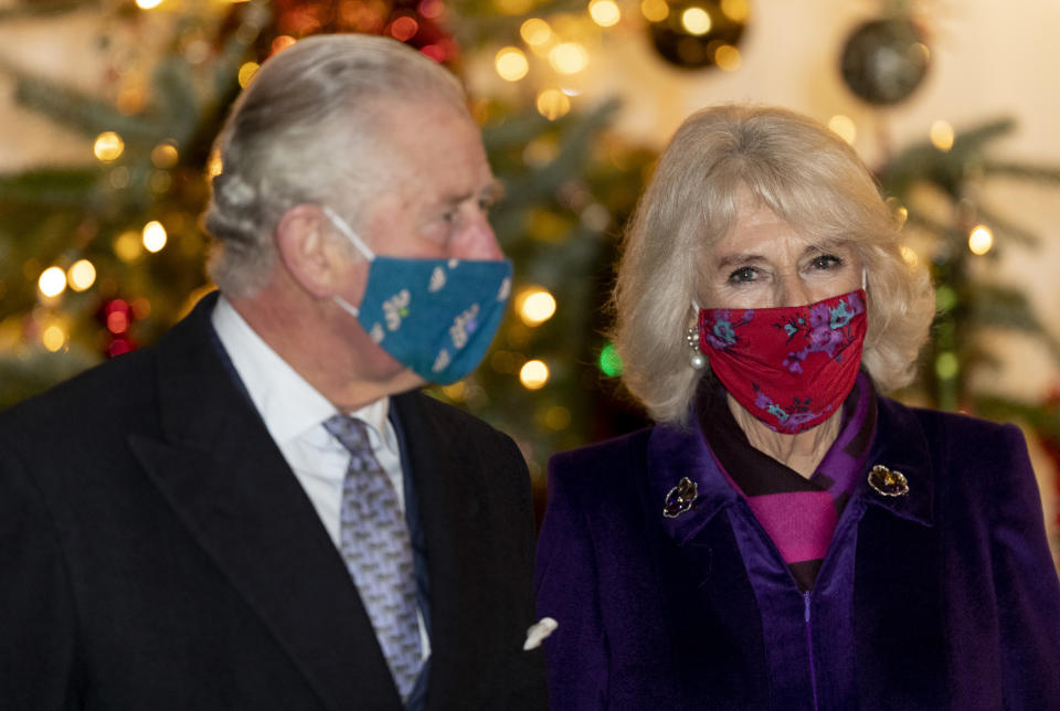 WINDSOR, ENGLAND - DECEMBER 08: Camilla, Duchess of Cornwall and Prince Charles, Prince of Wales during an event to thank local volunteers and key workers in the Quadrangle at Windsor Castle on December 8, 2020 in Windsor, England. (Photo by UK Press Pool/UK Press via Getty Images)