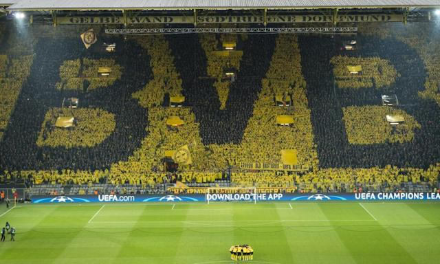 "<span class=""element-image__caption"">Dortmund's players and fans prepare for the hastily rescheduled match against Monaco.</span> <span class=""element-image__credit"">Photograph: Alexandre Simoes/Getty Images</span>"