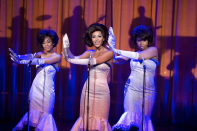 <p><em>Dreamgirls </em>was inspired by the story of The Supremes and their record label, Motown. Reflecting the style of the film's 1960s time frame, the group wears strapless mid-length mermaid dresses that have become just as synonymous with the film as with The Supremes. </p>