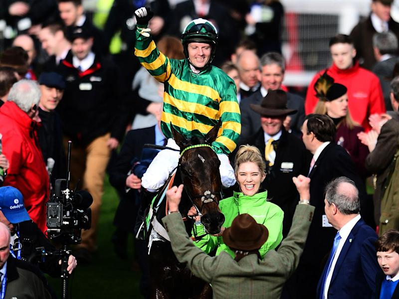 Noel Fehily on board Buveur D'air celebrates after winning the Stan James Champion Hurdle Challenge Trophy during Champion Day of the Cheltenham Festival: Getty