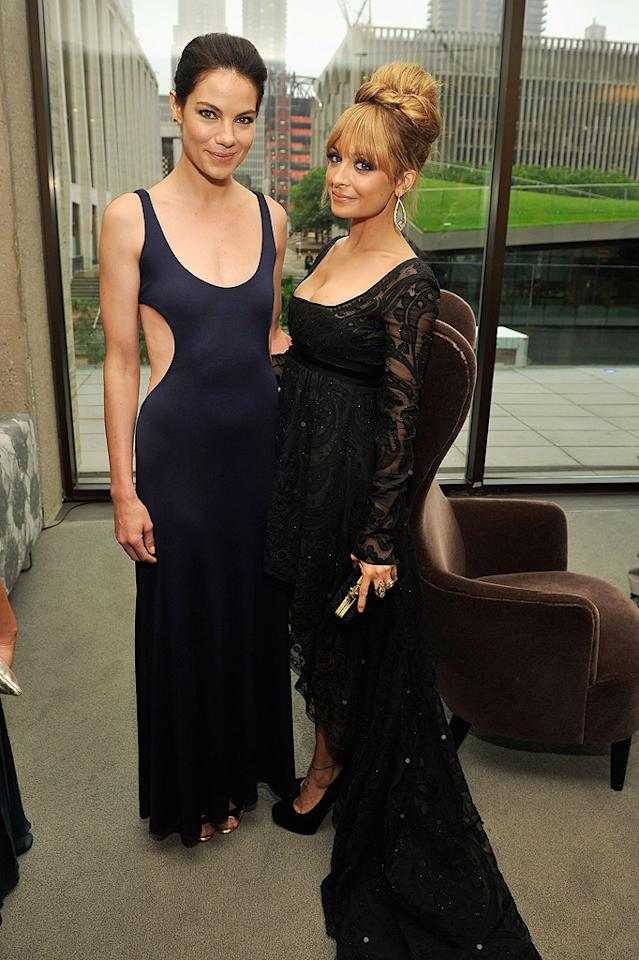 """""""Eagle Eye"""" actress Michelle Monaghan, in a sexy navy number with cutouts, and reality star-turned-designer Nicole Richie, in an Emilio Pucci dress, joined the presumably sweet smelling crowd at the Fragrance Foundation's 40th Anniversary FiFi Awards for perfume at Alice Tully Hall in NYC's Lincoln Center on Monday. (5/21/2012)"""