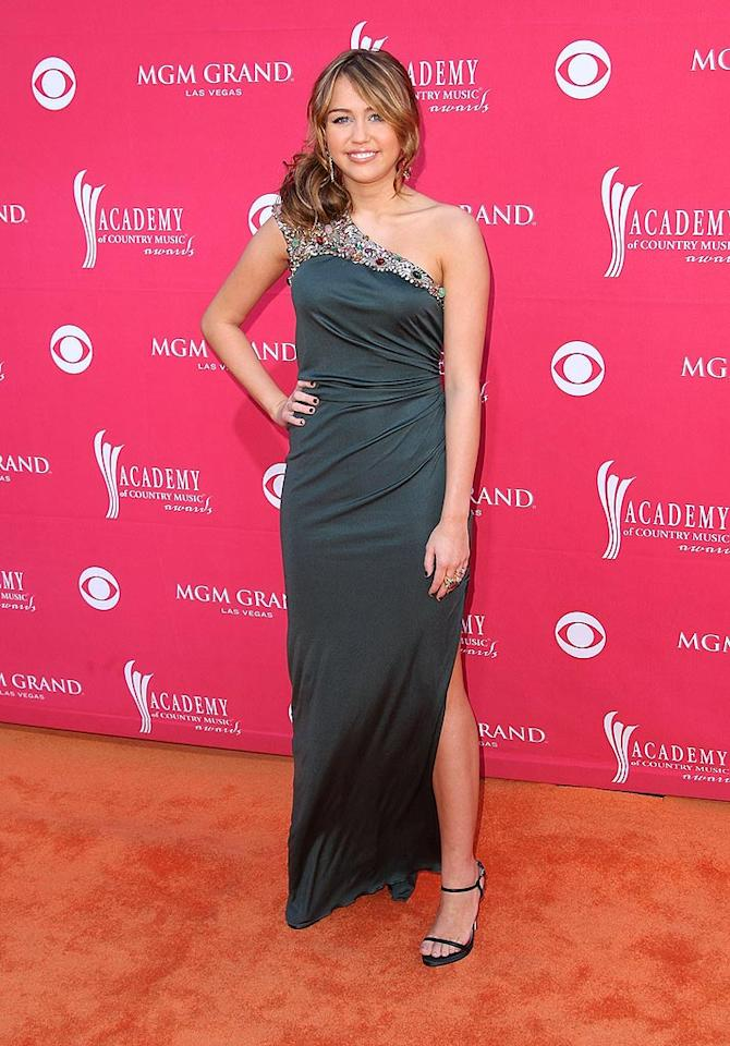 "Miley Cyrus dressed to impress in a bedazzled Monique Lhuillier floor-length dress and strappy heels. Jason Merritt/<a href=""http://www.gettyimages.com/"" target=""new"">GettyImages.com</a> - April 5, 2009"