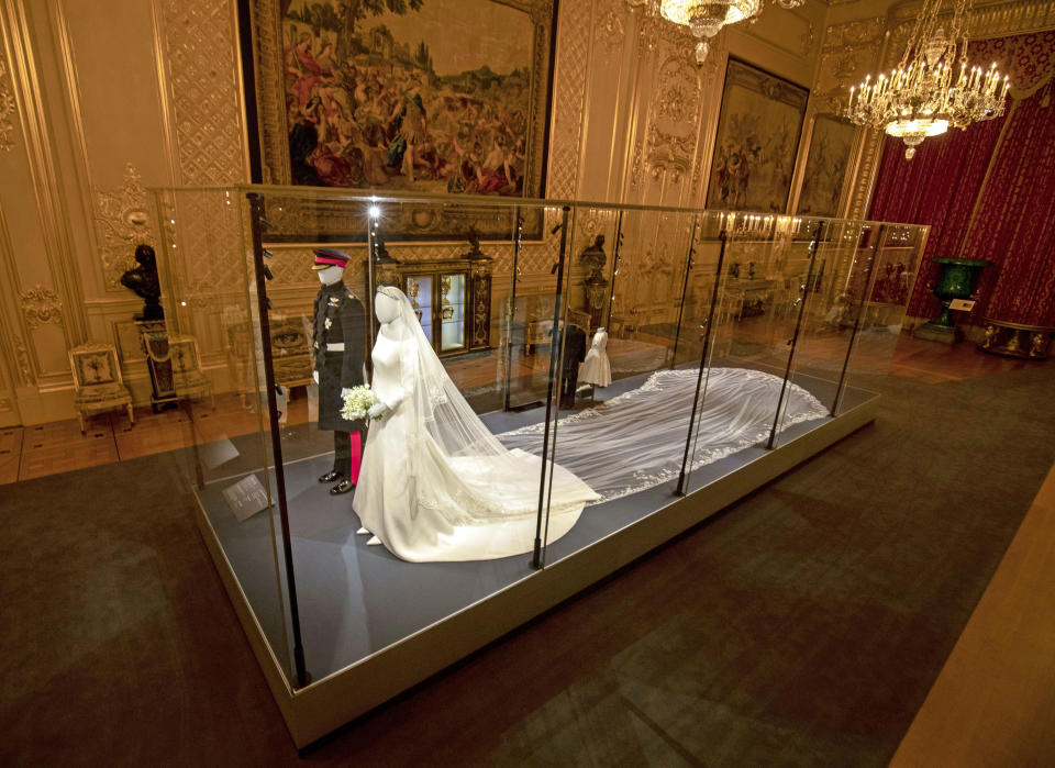 """File photo dated 25/10/2018 of the wedding outfits of the Duke and Duchess of Sussex on display in the Grand Reception Room at Windsor Castle, Berkshire as the Royal Collection Trust is seeking voluntary redundancies amid the """"greatest challenge"""" in its history."""