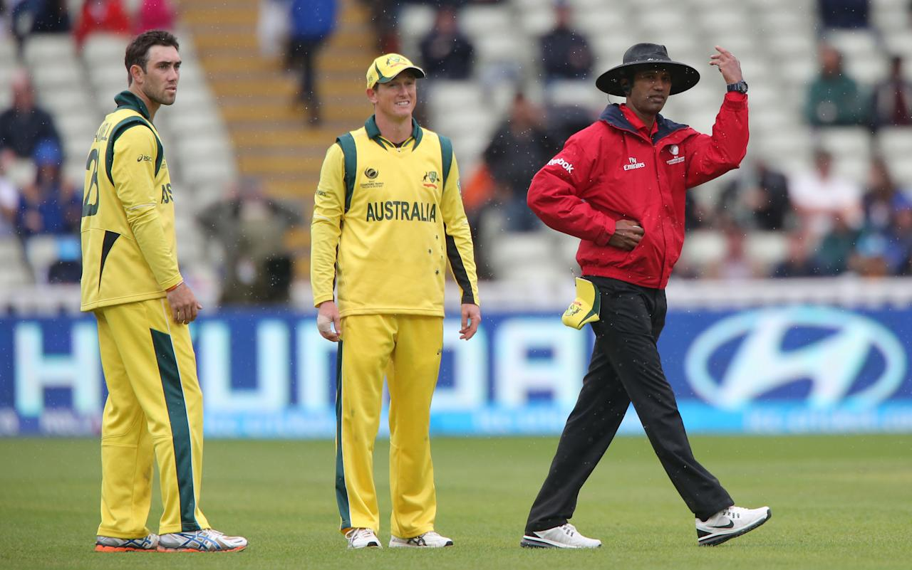 Australia Captain George Bailey (centre) and Glenn Maxwell (left) watch umpire H D P K Dkarmasena takes the players off due to rain against New Zealand, during the ICC Champions Trophy match at Edgbaston, Birmingham.