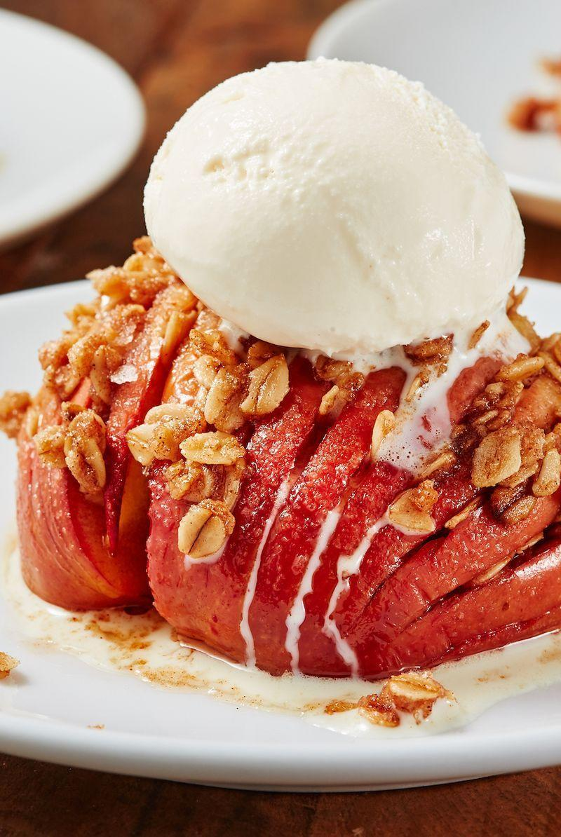 """<p>You need to try this hasselback trick with apples ASAP. It tastes like a cross between a <a href=""""https://www.delish.com/uk/cooking/recipes/a29756533/mcdonalds-apple-pie-recipe-del0313/"""" rel=""""nofollow noopener"""" target=""""_blank"""" data-ylk=""""slk:homemade apple pie"""" class=""""link rapid-noclick-resp"""">homemade apple pie</a> and a <a href=""""https://www.delish.com/uk/cooking/recipes/a30253890/healthy-apple-crumble/"""" rel=""""nofollow noopener"""" target=""""_blank"""" data-ylk=""""slk:warm apple crumble"""" class=""""link rapid-noclick-resp"""">warm apple crumble</a>. The best part: You don't need to deal with rolling out and chilling pie dough. </p><p>Get the <a href=""""https://www.delish.com/uk/cooking/recipes/a32262439/crustless-apple-pies-recipe/"""" rel=""""nofollow noopener"""" target=""""_blank"""" data-ylk=""""slk:Crustless Apple Pies"""" class=""""link rapid-noclick-resp"""">Crustless Apple Pies</a> recipe.</p>"""