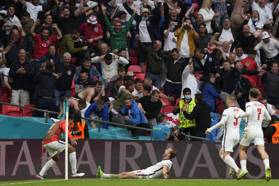 England's Harry Kane, center, celebrates after scoring his side's second goal during the Euro 2020 soccer championship round of 16 match between England and Germany at Wembley stadium in London, Tuesday, June 29, 2021. (AP Photo/Frank Augstein, Pool)