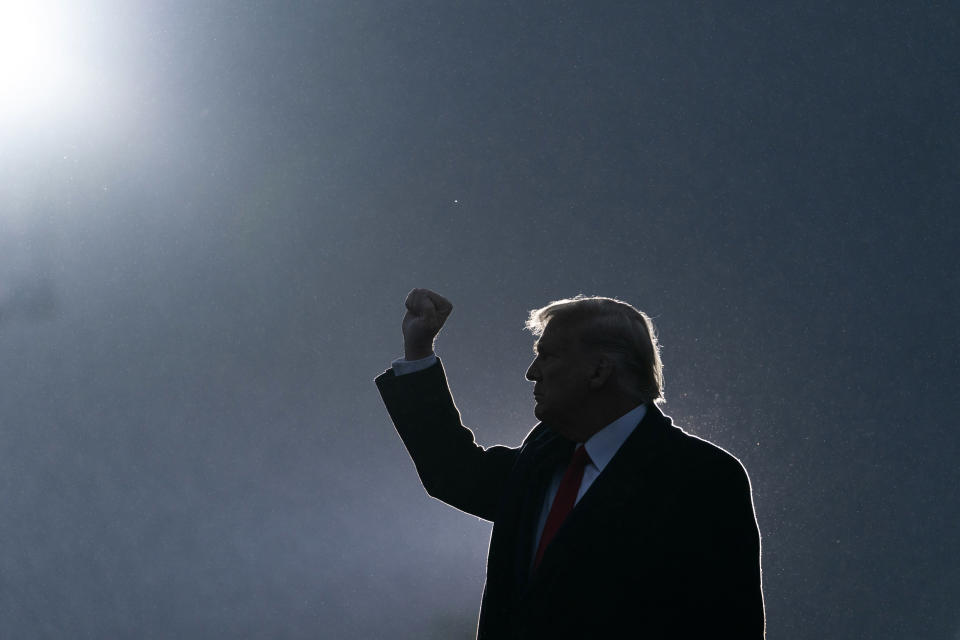 President Donald Trump pumps his fist as he departs after speaking at a campaign rally at Altoona-Blair County Airport, Monday, Oct. 26, 2020, in Martinsburg, Pa. (AP Photo/Alex Brandon)