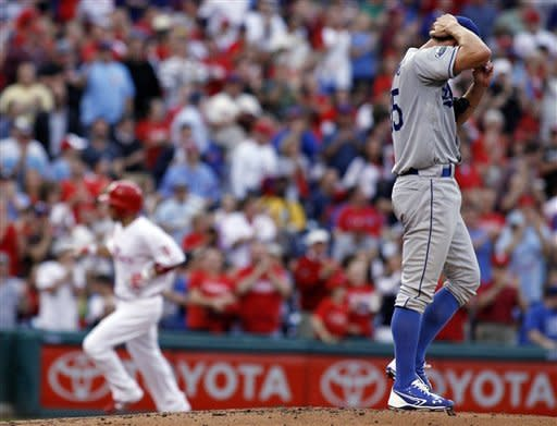 Los Angeles Dodgers starting pitcher Chris Capuano stands on the mound after Philadelphia Phillies' Shane Victorino hit a solo home run in the second inning of a baseball game, Wednesday, June 6, 2012, in Philadelphia. (AP Photo/H. Rumph Jr)
