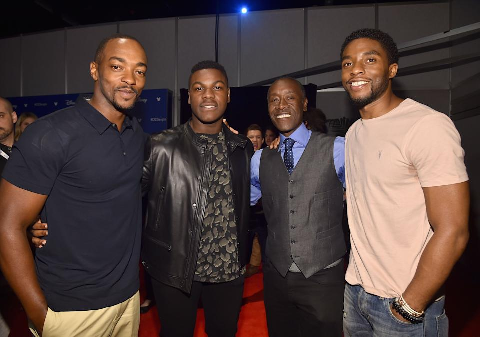 From left to right, Anthony Mackie, John Boyega, Don Cheadle and Chadwick Boseman appear at Disney's D23 EXPO 2017 in Anaheim, California. (Photo: Alberto E. Rodriguez via Getty Images)
