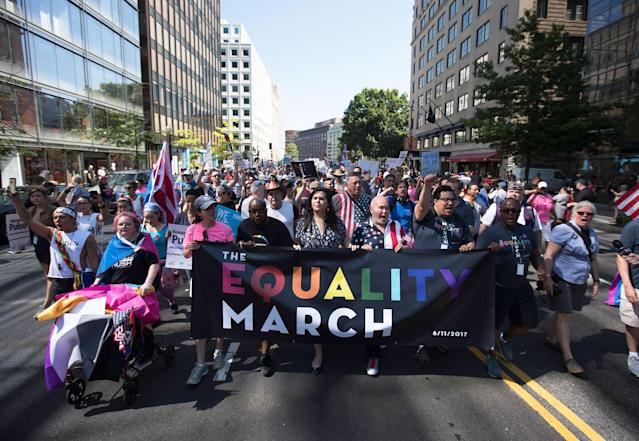 <p>The front of the Equality March for Unity and Pride moves down 17th Street NW toward the White House in Washington, Sunday, June 11, 2017. (Photo: Carolyn Kaster/AP) </p>