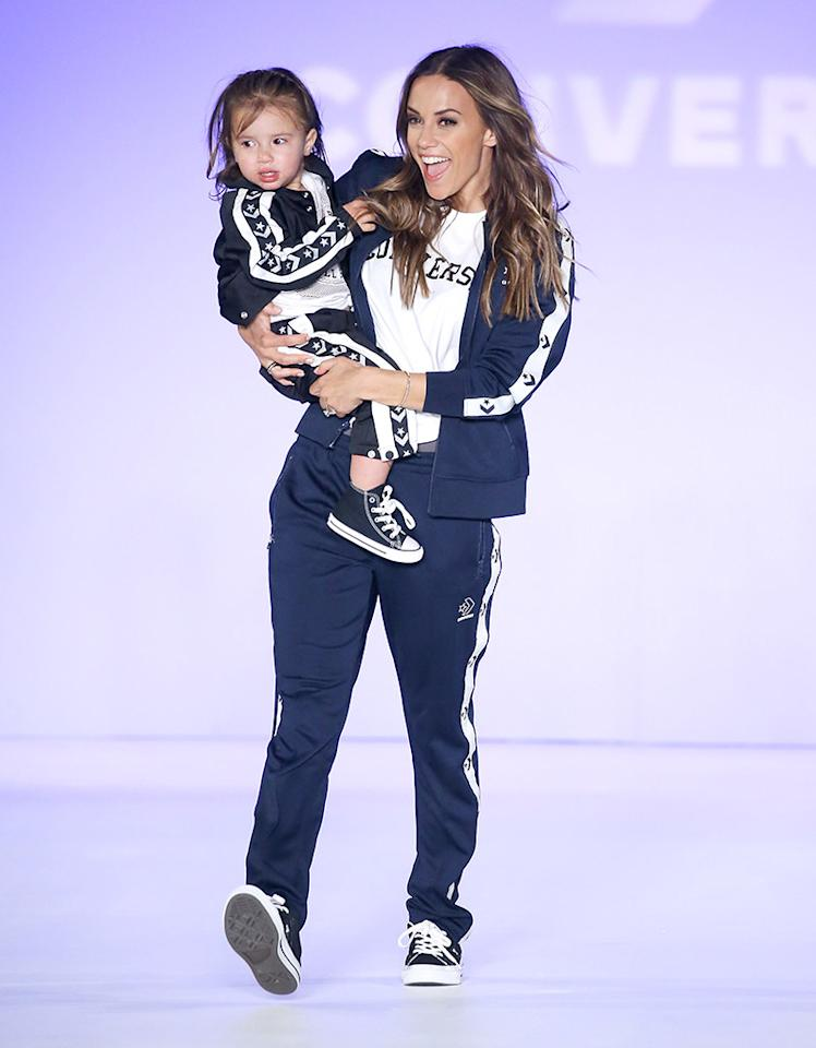 <p>The country crooner and daughter Jolie Rae, 2, who was making her modeling debut, walked the runway and waved to their fans during the 2018 Rookie USA Show in L.A. (Photo: Michael Tran/Getty Images) </p>