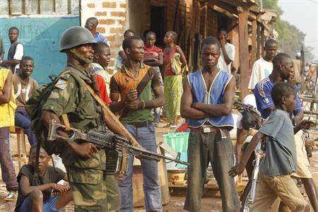 Democratic Republic of the Congo soldiers, part of an African peacekeeping force, patrol along a street in Bangui