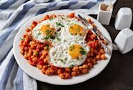 <p>Chickpeas and eggs make for a filling and inexpensive meal on their own, but together you'll be getting a protein packed, flavor blasting dish. Cook the chickpeas in a pan with some oil and serve them as a base alonside spinach and tomatoes with a runny egg on top. </p>
