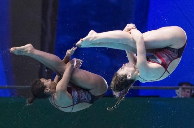 Canada's Jennifer Abel, left, and Melissa Citrini-Beaulieu won silver in women's 3-metre synchro at a diving World Cup event in Tokyo on Saturday.  (Graham Hughes/Canadian Press/File - image credit)