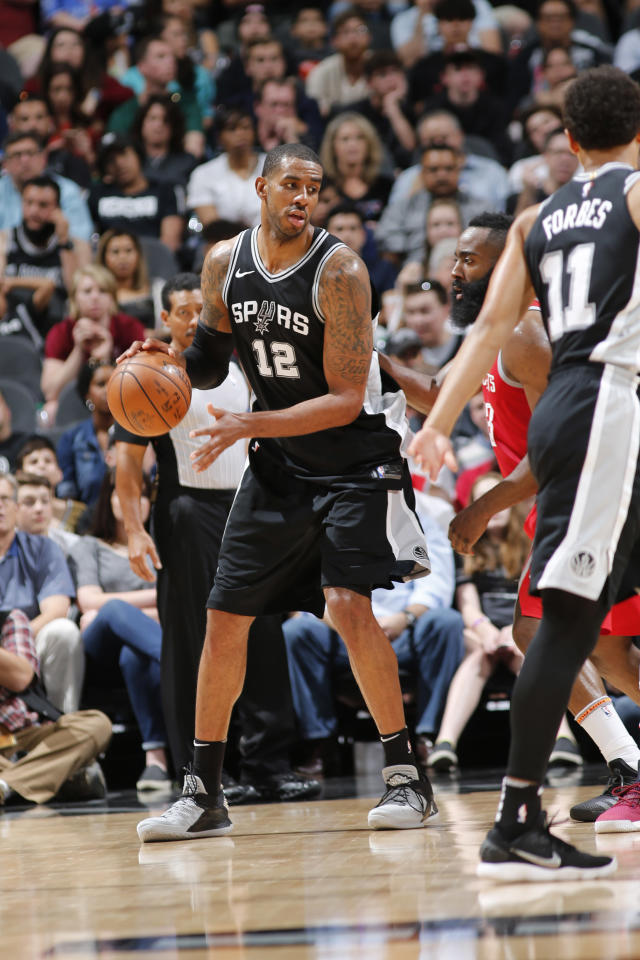 SAN ANTONIO, TX - APRIL 1: LaMarcus Aldridge #12 of the San Antonio Spurs looks to pass the ball during the game against the Houston Rockets on April 1, 2018 at the AT&T Center in San Antonio, Texas