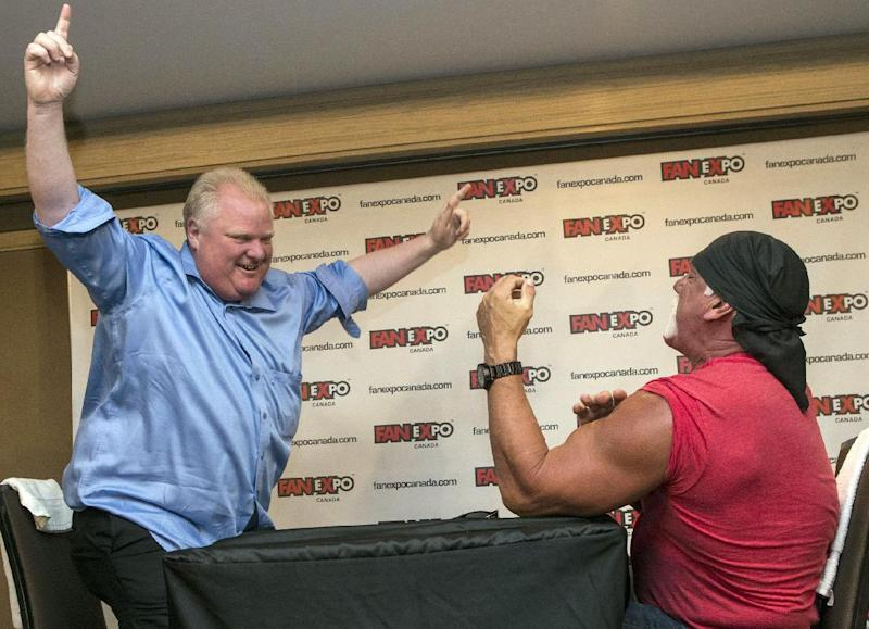 Toronto City Mayor Rob Ford, left, celebrates after defeating wrestler Hulk Hogan in an arm-wrestling match to promote Fan Expo in Toronto on Friday, Aug. 23, 2013 . (AP Photo/The Canadian Press, Chris Young)