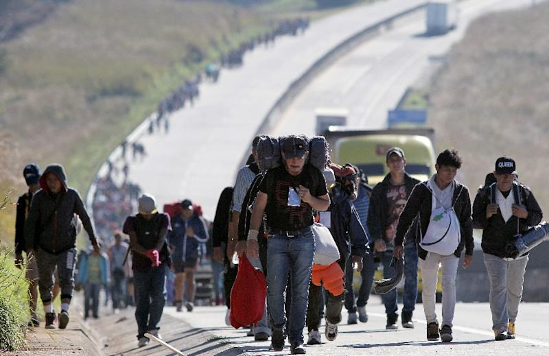 The migrants have traveled more than 2,000 kilometers (1,250 miles) so far (AFP Photo/ULISES RUIZ)