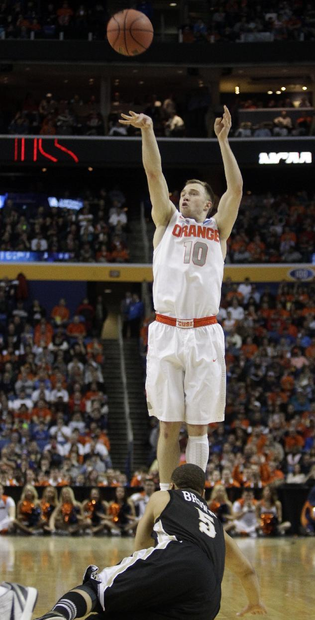 Syracuse's Trevor Cooney (10) shoots over Western Michigan's David Brown (5) during the first half of a second-round game in the NCAA college basketball tournament in Buffalo, N.Y., Thursday, March 20, 2014. (AP Photo/Bill Wippert)