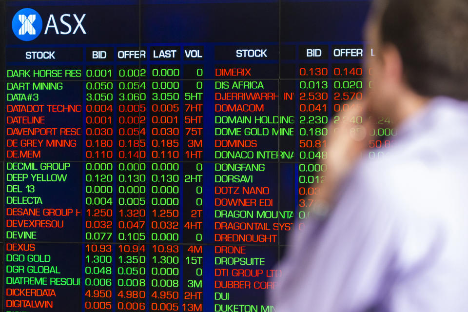 SYDNEY, AUSTRALIA - MARCH 13: A man looks at the electronic display of stocks at the Australian Stock Exchange on March 13, 2020 in Sydney, Australia. The ASX200 plunged more than 7 percent in the first 15 minutes of trade on Friday, amid fears over the spread of COVID-19. The Australian sharemarket fall follows the worst day of trading on Thursday, which saw the worst losses since the Global Financial Crisis. (Photo by Jenny Evans/Getty Images)
