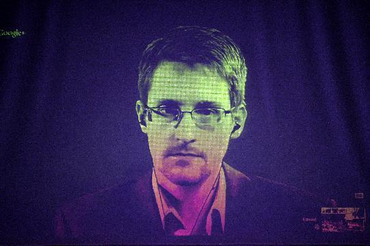 File photo taken on June 24, 2014 shows US whistleblower Edward Snowden speaking to European officials via videoconference during a parliamentary hearing at the Council of Europe in Strasbourg, eastern France (AFP Photo/Frederick Florin)