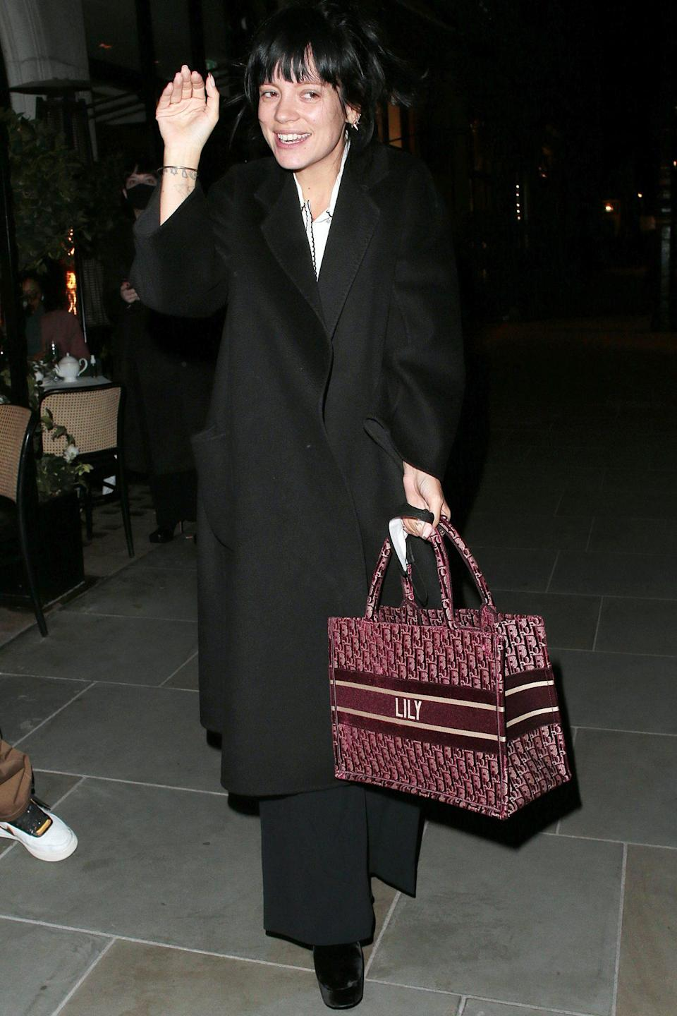 <p>Lily Allen leaves Scott's restaurant in London on Monday with a monogrammed bag. </p>