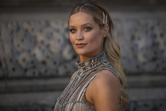 Laura Whitmore poses for photographers upon arrival at the BAFTA Film Awards in London in 2019. (Vianney Le Caer/Invision/AP)