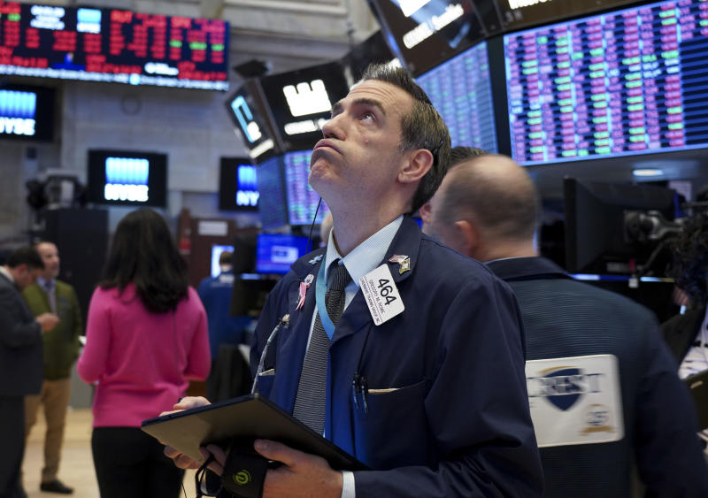 NEW YORK, Feb. 25, 2020 -- Traders work at New York Stock Exchange in New York, the United States, Feb. 25, 2020. U.S. stocks closed sharply lower on Tuesday, continuing a broad market sell-off amid rising risk-averse sentiment. The Dow Jones Industrial Average lost 879.44 points, or 3.15 percent, to 27,081.36. The S&P 500 was down 97.68 points, or 3.03 percent, to 3,128.21. The Nasdaq Composite Index decreased 255.67 points, or 2.77 percent, to 8,965.61. (Photo by Zhang Mocheng/Xinhua via Getty) (Xinhua/Zhang Mocheng via Getty Images)