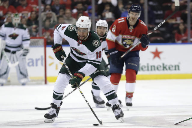 Minnesota Wild left wing Jordan Greenway (18) skates with the puck during the second period of an NHL hockey game against the Florida Panthers, Tuesday, Dec. 3, 2019, in Sunrise, Fla. (AP Photo/Lynne Sladky)