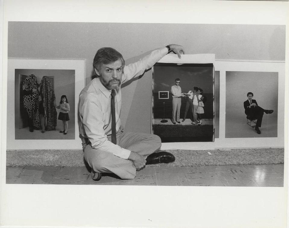 Fred Tasker with an oversize Polaroid that featured his image made by artist William Wegman.