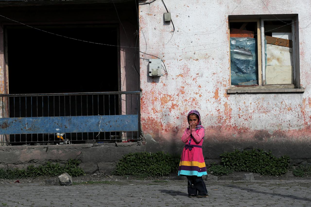 An Afghan migrant girl stands in front of her home in Kars, eastern Turkey, April 11, 2018. Picture taken April 11, 2018. REUTERS/Umit Bektas     TPX IMAGES OF THE DAY