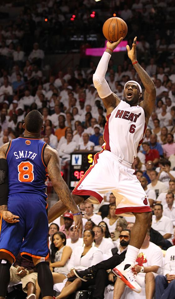 MIAMI, FL - MAY 09:  Forward LeBron James #6 of the Miami Heat shoots against the New York Knicks in Game Five of the Eastern Conference Quarterfinals in the 2012 NBA Playoffs  on May 9, 2012 at the American Airines Arena in Miami, Florida. Miami defeated the Knicks 106-94 to advance to the next round four games to one.  NOTE TO USER: User expressly acknowledges and agrees that, by downloading and or using this photograph, User is consenting to the terms and conditions of the Getty Images License Agreement.  (Photo by Marc Serota/Getty Images)