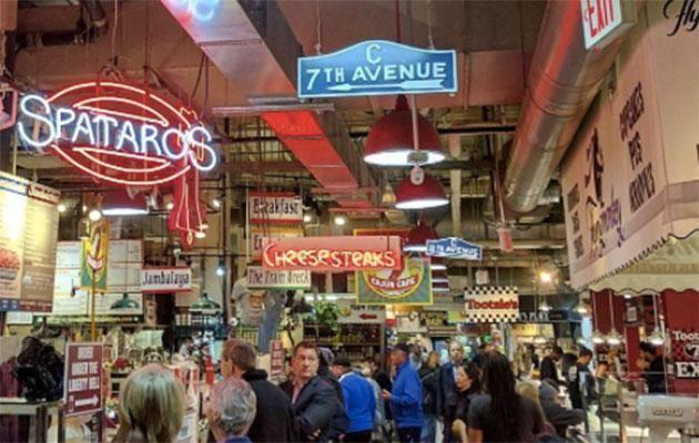 Bars, flower market, cafes, patisseries and bakeries - you'll find everything at Reading Terminal Market. Photo: Discover Philly