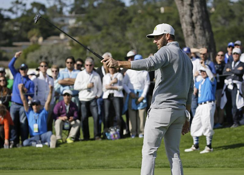 Dustin Johnson reacts after making a birdie putt on the 16th green of the Pebble Beach Golf Links during the final round of the AT&T Pebble Beach National Pro-Am golf tournament Sunday, Feb. 12, 2017, in Pebble Beach, Calif. Johnson finished in third place at total 14-under-par. (AP Photo/Eric Risberg)