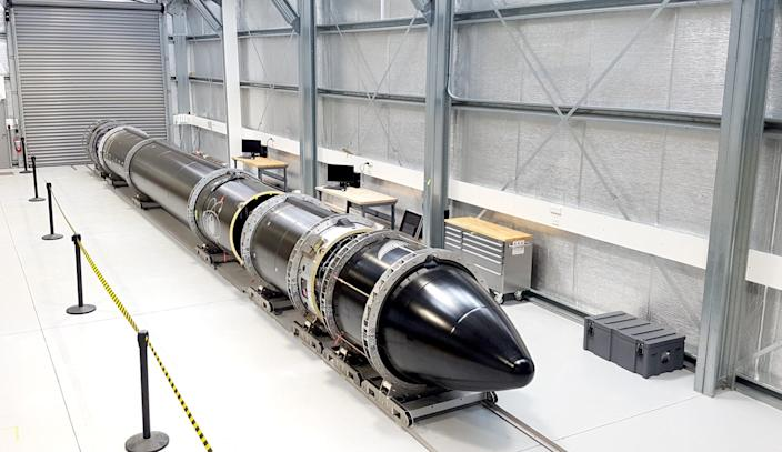 Rocket Lab's 3D-printed Electron launcher in a hangar.