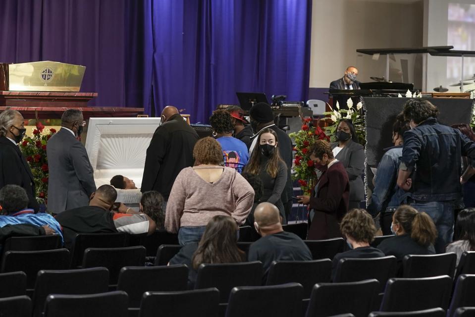 Family members pay their respects during a visitation for Daunte Wright Wednesday, April 21, 2021, in Minneapolis. Daunte Wright was fatally shot by a police officer during a traffic stop. (AP Photo/Morry Gash)