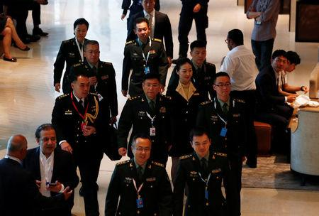 FILE PHOTO: People's Liberation Army's Lieutenant-General He Lei (C) arrives at the IISS Shangri-la Dialogue in Singapore June 1, 2018. REUTERS/Edgar Su/File Photo