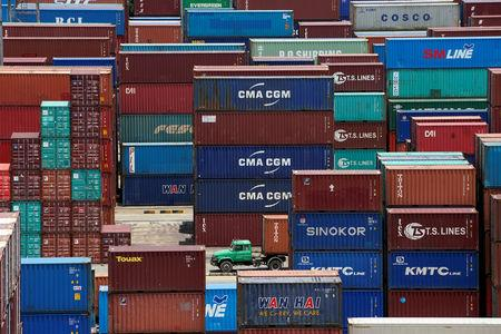 Shipping containers are seen at a port in Shanghai, China July 10, 2018. REUTERS/Aly Song/Files