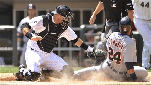 Chicago White Sox catcher A.J. Pierzynski left, tags out Detroit Tigers' Miguel Cabrera at home plate in the first inning during a baseball game in Chicago, Tuesday, May, 15, 2012. Cabrera attempted to score from first on a double by Prince Fielder. (AP Photo/Paul Beaty)